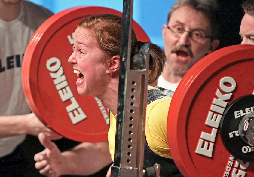A competitive powerlifter squatting