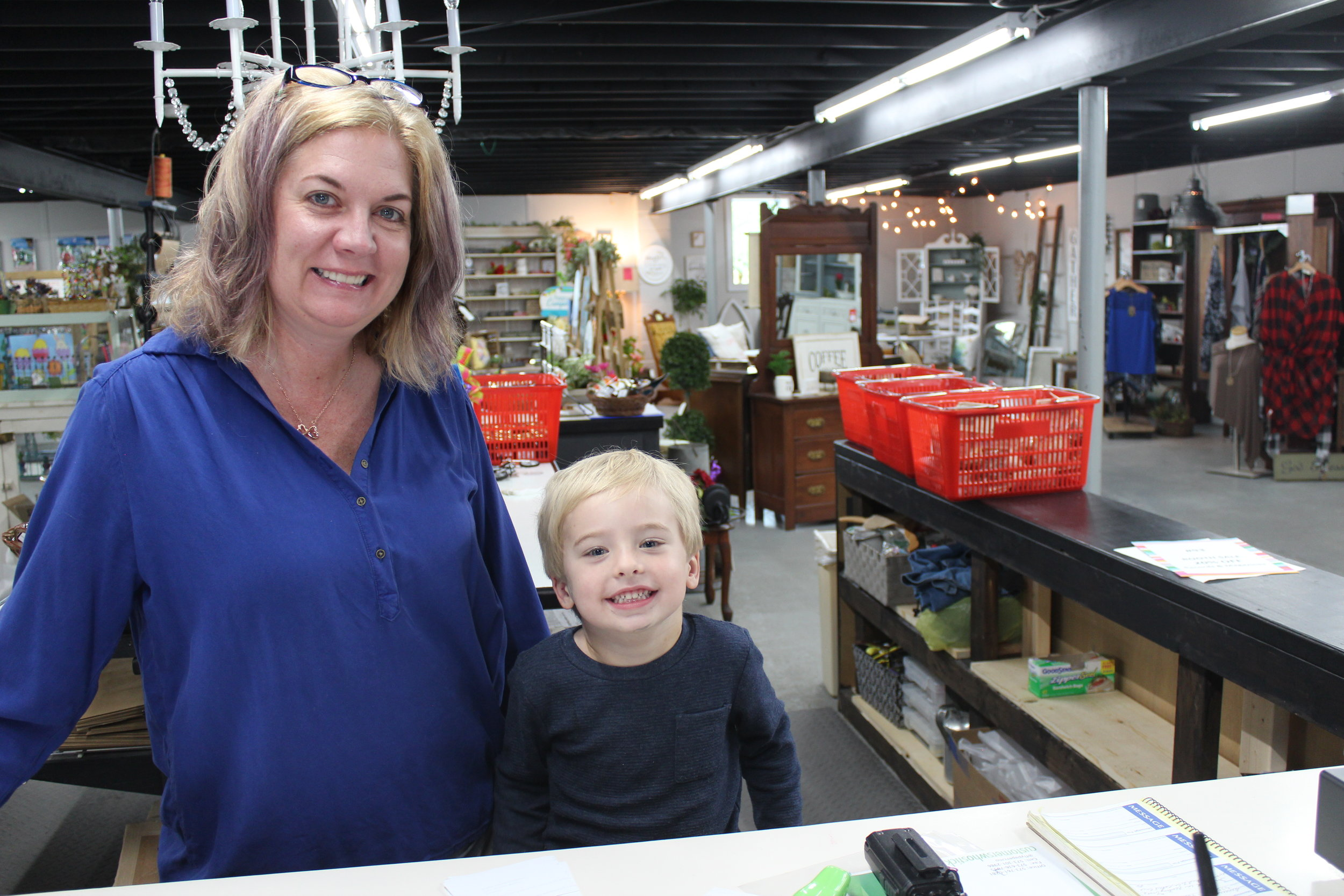 Cherri can often find some extra help at the front counter when her grandson, Brady, comes in.