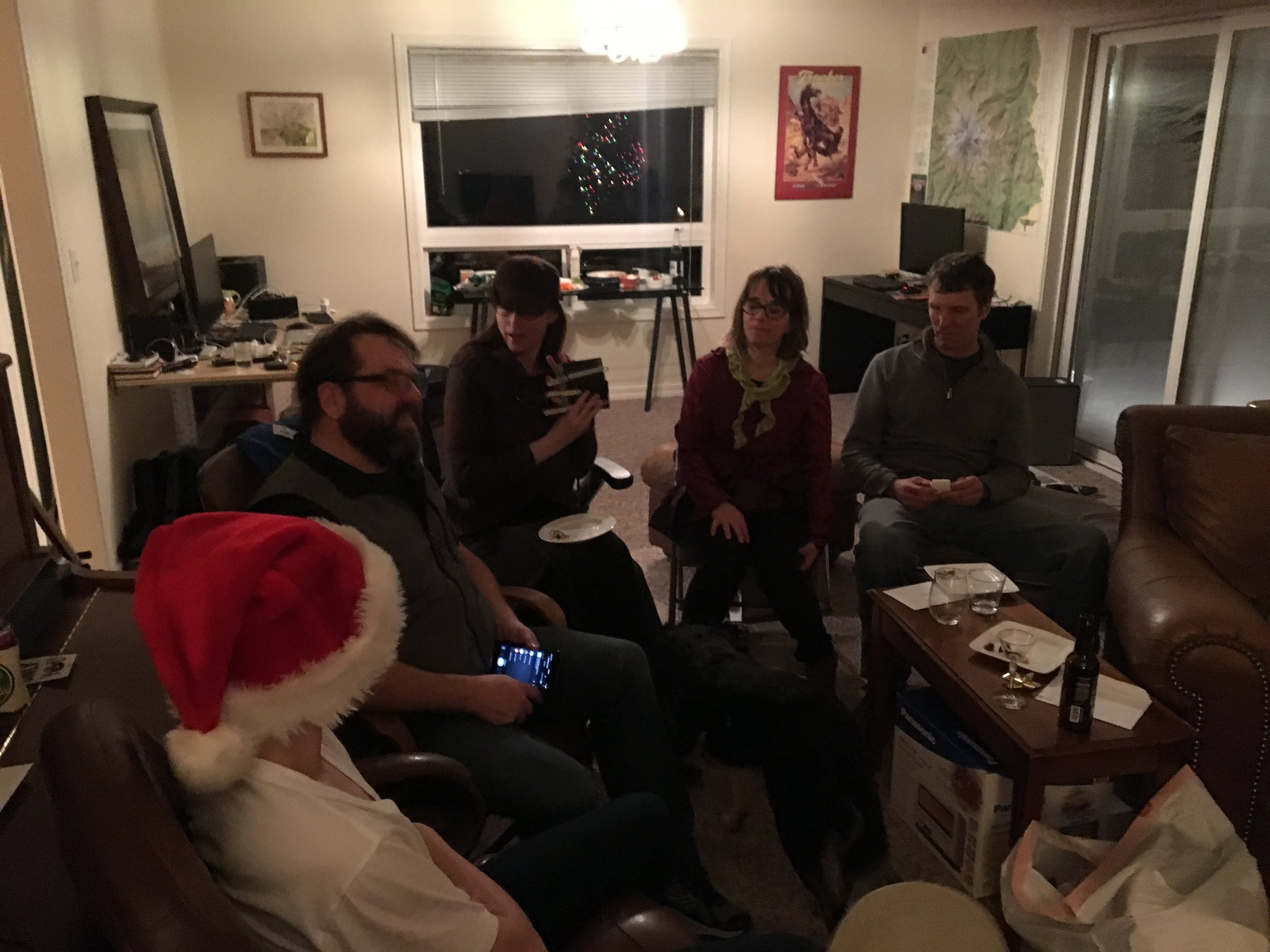 - Christmas Eve at Joel's.  Opening presents, from the left, Lucas (Joel's son), Joel, Tracie, Jenny, and Scott.