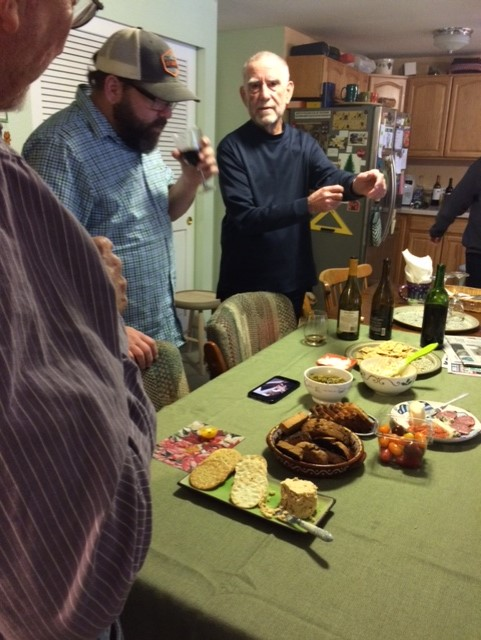 - From the left, Michael Clough, Joel, and Ron discussing the homemade wine that Joel produced.