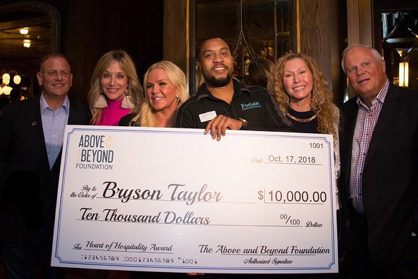 Bryson Taylor Receives $10K from TAABF during IMEX -