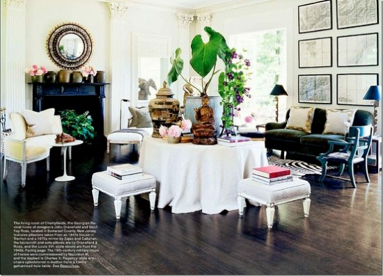 {This casually skirted round table takes center stage in this living space. From  Dransfield & Ross .}