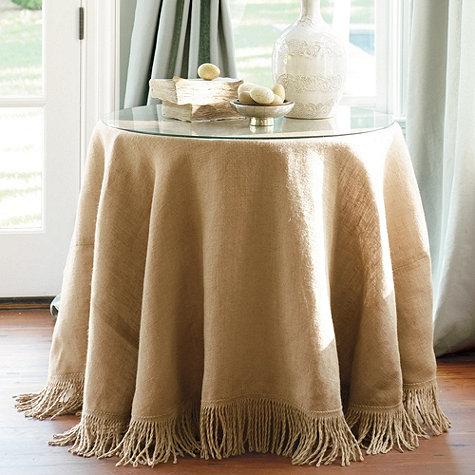 {Classic burlap table skirt with fringe. Lovely! From  Ballard Designs .}