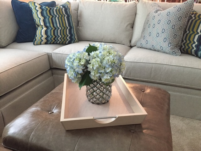 {Blue is the personality color in this family room with a neutral base, design by April Force Pardoe Interiors.}