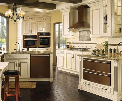 {Oiled bronze appliances by Jenn Air. They work so well with the cream cabinets.}