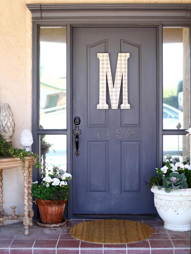 {A mid-tone gray is a great, classic color for a front door, from  meandjilly.blogspot.com }