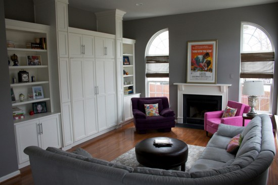 {Gray walls are a lovely backdrop to hot pinks and purples in this family room. Design by  AFP Interiors .}