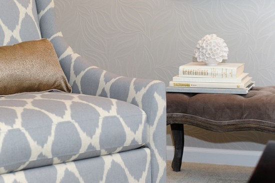 {Gray takes center stage on this accent chair in a bold pattern. Set against a gray painted wallpaper. Design by  AFP Interiors .}