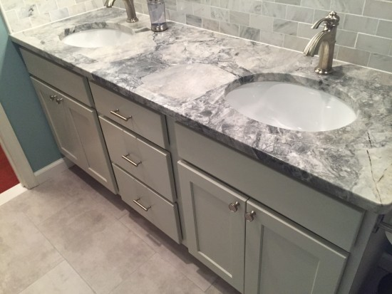 {Grays and whites create a lovely quartzite countertop in this bathroom. Design by  AFP Interiors .}
