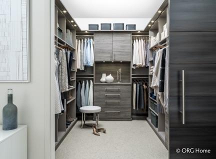{Master bedroom closet system by  Cornerstone Closets .}