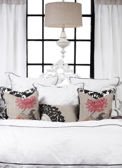 {A dash of pink against a white bed is fresh and romantic. From  Urban Threads  in Baltimore.}