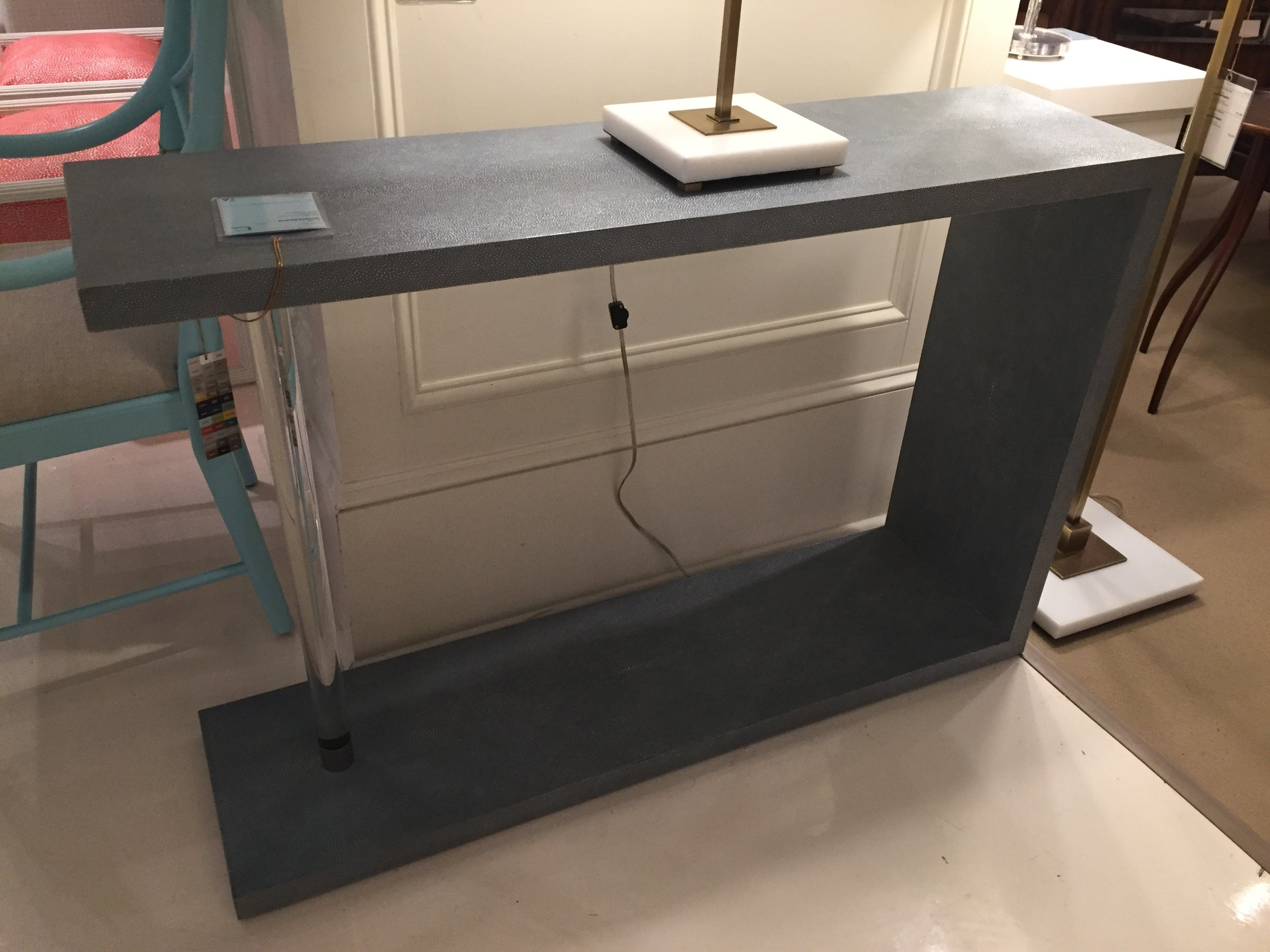 {Glass and wood console table from  Theodore Alexander .}