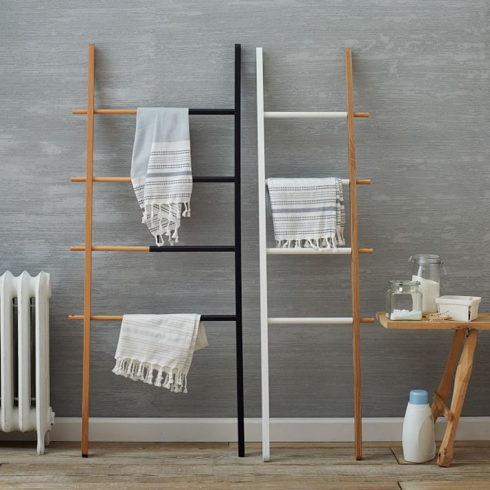 {Dare to be decorative with a trendy ladder towel rack. From:  West Elm .}