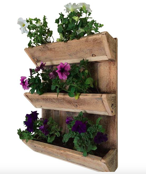 {I am swooning over this three-tiered wood wall planter. What a unique way to plant (and show off) your herb garden! From:  Houzz .}