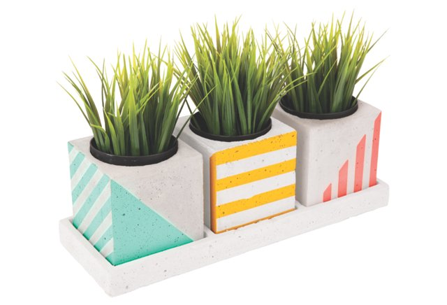 {This trio of SunnyLIFE herb planters boasts summer-friendly colors in geometric, retro-esque patterns. Pair them with like-colored accessories like an accent rug or seat cushions for a complete look. From:  One Kings Lane .}