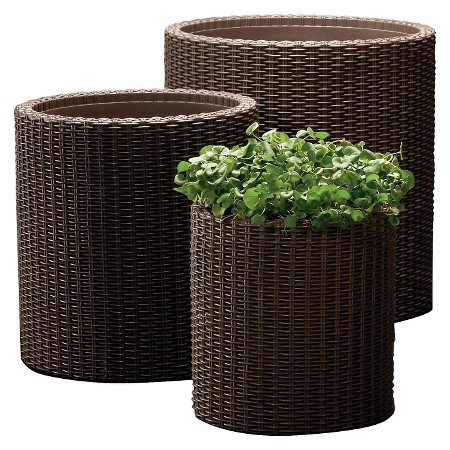 {The cylindrical shape of these floor planters is a touch different from the more traditional box or tall and tapered versions. They'll blend seamlessly with rattan furniture! From:  Target .}