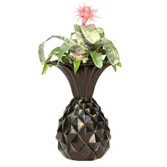 {Flowers with a side fruit. Packing a punch of personality, this unique pineapple sculpture urn is kitschy and full of character. From:  Frontgate .}