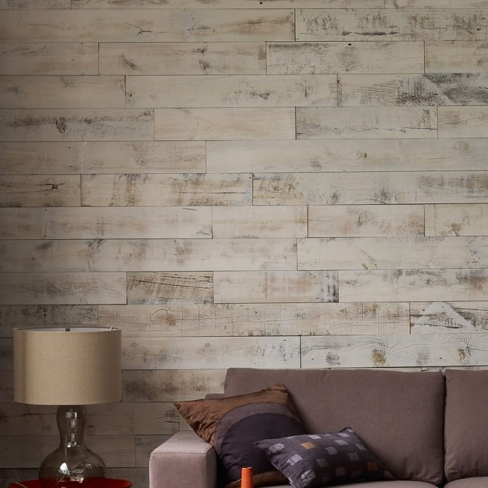{These Stikwood weathered panels add depth, texture and warmth to this living room. Best yet, they come in four finishes and are easy to install thanks to an adhesive backing. Let the paneling's character speak for itself or continue accessorizing with coordinating wall decor. From:  West Elm .}