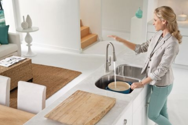 {Hands-free faucets, like Motionsense by Moen, help keep messes and germs to a minimum. This kitchen technology wow is Ideal for grimy hands that just cleaned chicken thighs or rolled a fresh batch of meatballs. Also, it is a great feature for little ones who can't fully reach the sink; allow them to gain some independence in the kitchen! From:  Moen .}