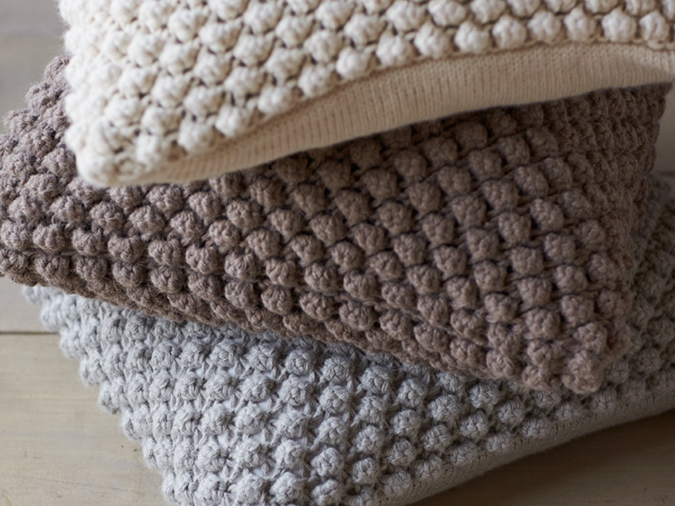 {Sustainably produced Alpaca pebble knit pillow, made from Alpaca fibers in Peru, makes a very luxurious decorative pillow. From  Coyuchi .}