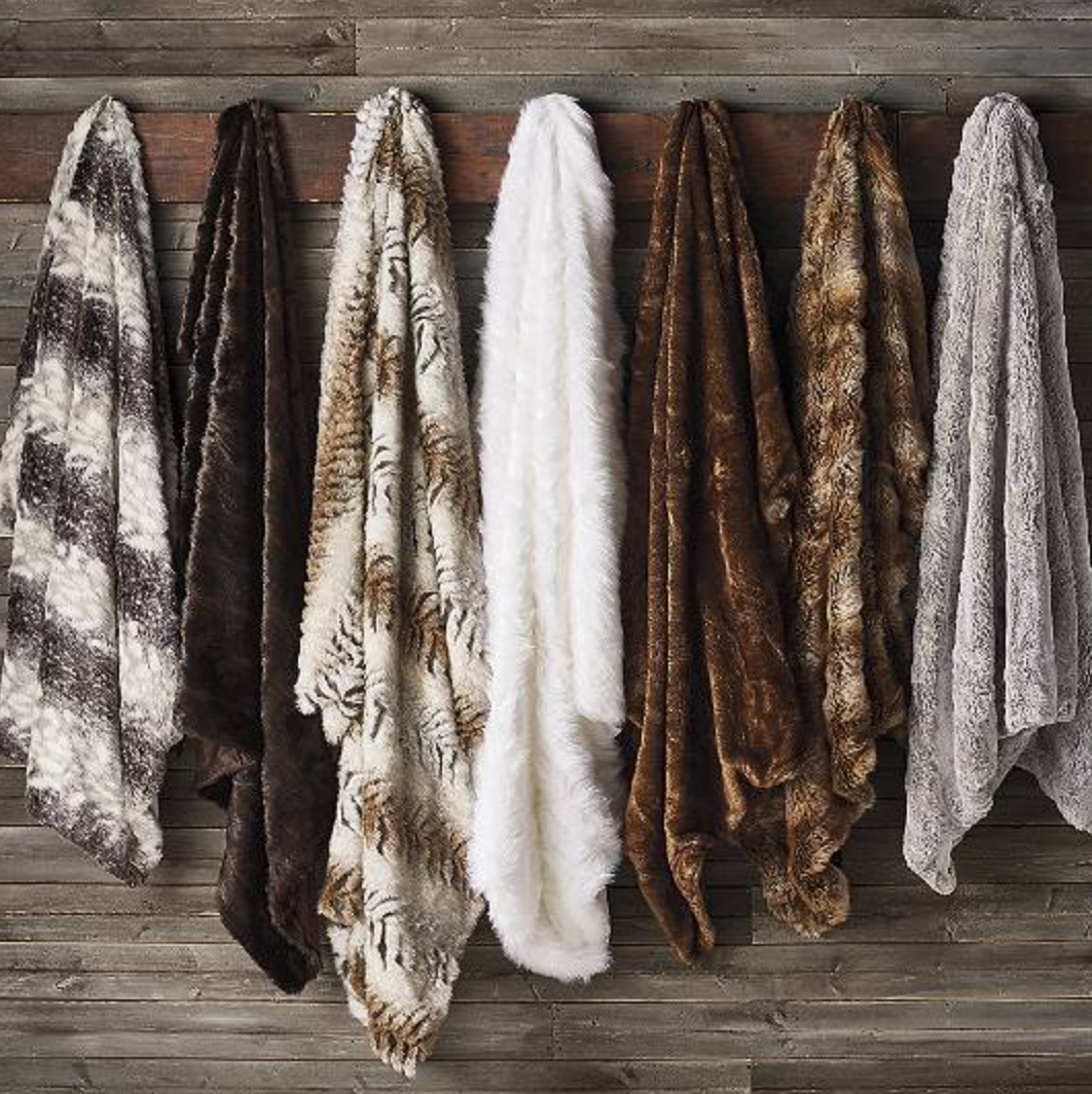 {Faux fur throw in sophisticated colors, from  Frontgate .}