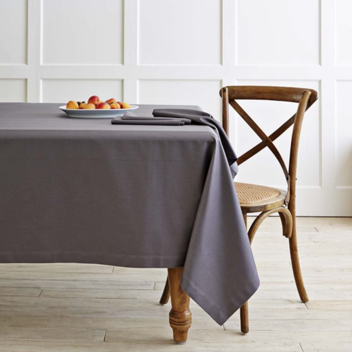 {Add a monogram to this cotton tablecloth to add a bit of luxury to your table. From  Williams Sonoma .}