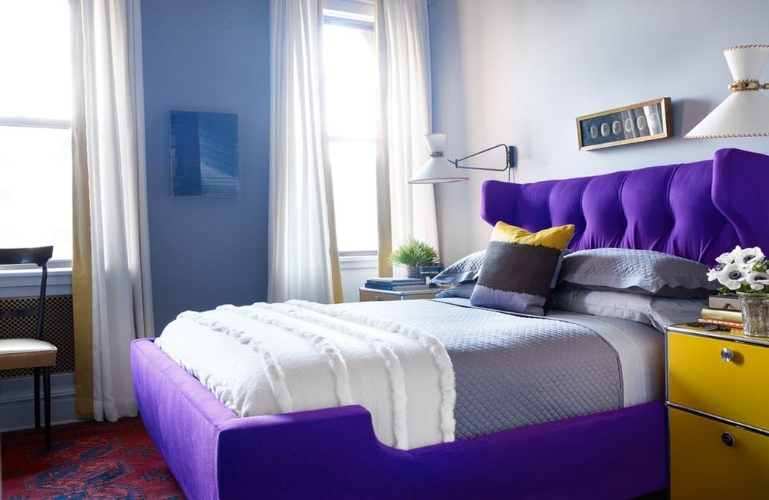 {This bedroom became a whole lot dreamier with an Ultra Violet statement bed frame and its complementary canary yellow nightstand. From:  Apartment Therapy. }