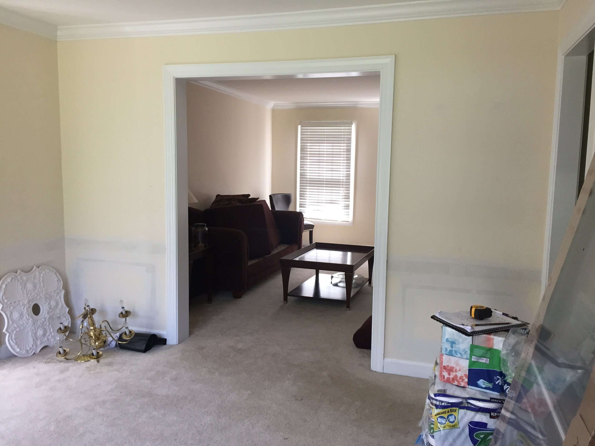 {BEFORE, Dining room looking into living room}