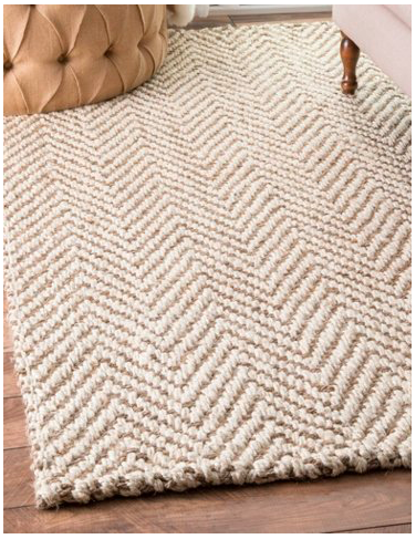 {Jute rug with a geometric patterns adds visual interest to a room without adding color. From:  One Kings Lane .}