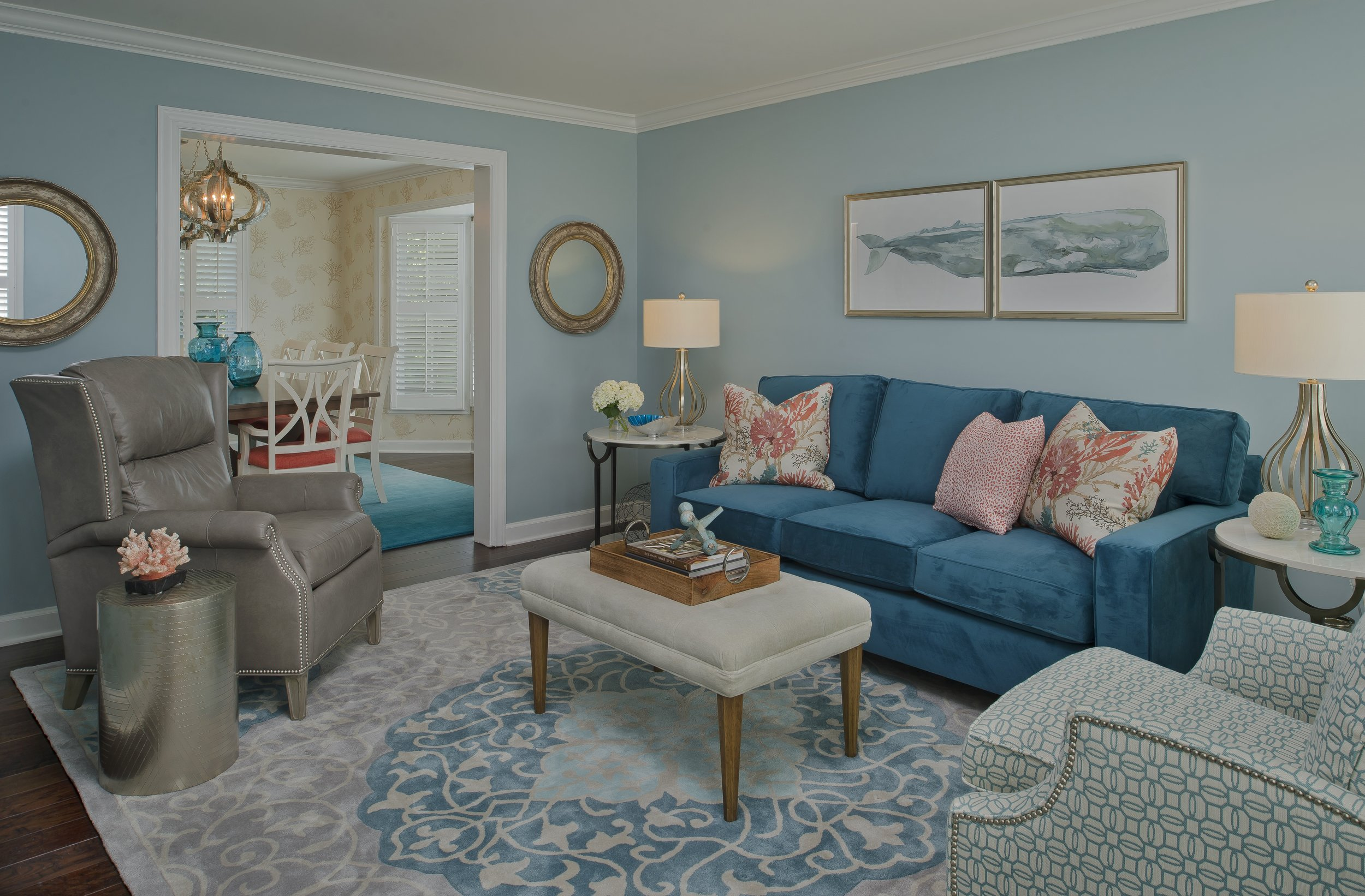 {The living and dining room area rugs would pair well in adjacent rooms because the teal color ties them together. Design by  April Force Pardoe Interiors .}