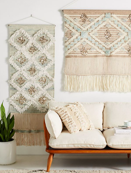 {An alternative to artwork or family photos, woven wall hangings add a chic texture and charming warmth to a living space. From:  Anthropologie .}