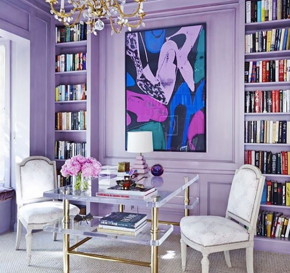 {On one side of the spectrum, bright lavender walls absolutely energize this luxurious home office. Design by  Daun Curry .}