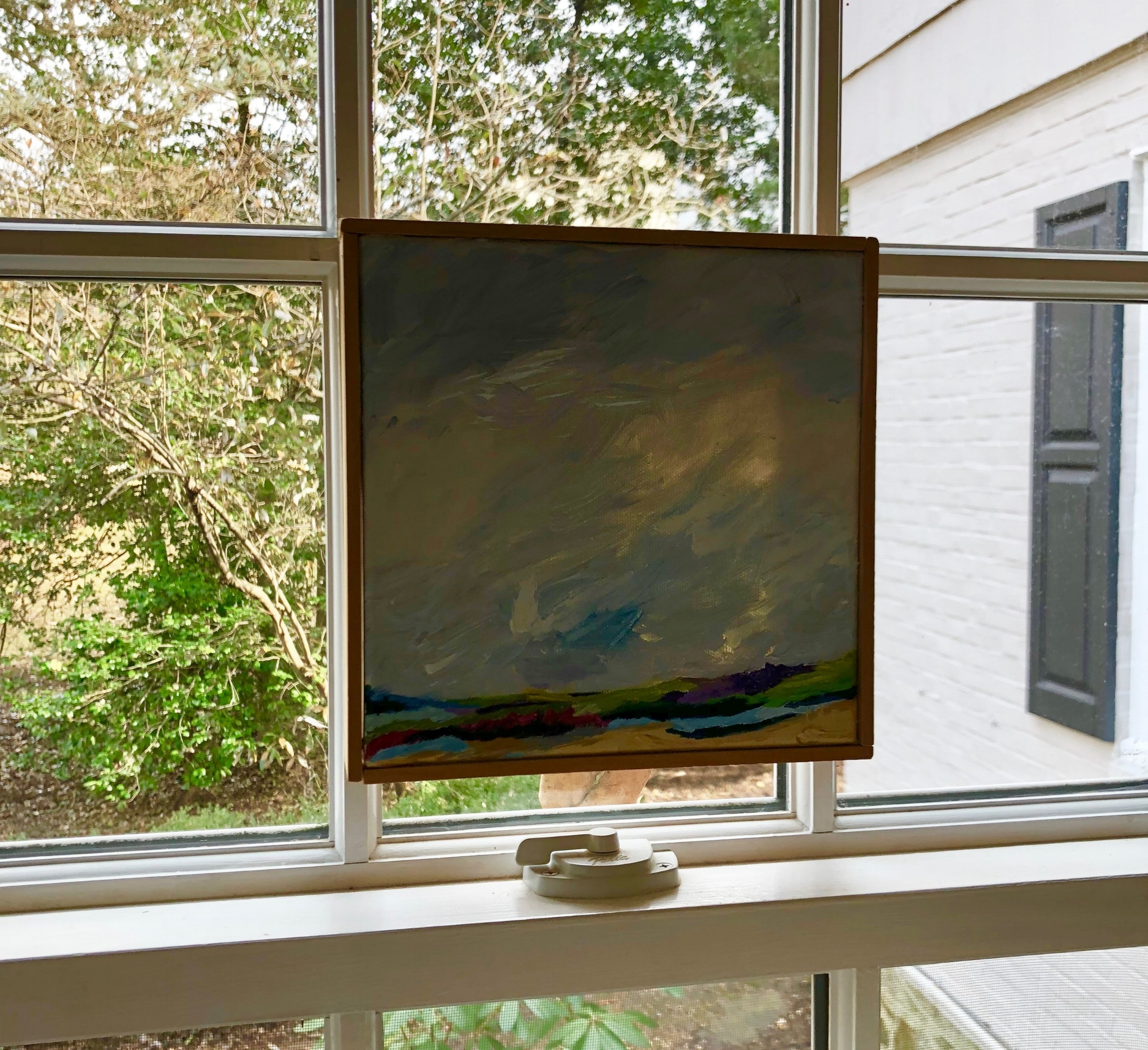 {Mary's friend painted this piece for her and it hangs, on the window, above her desk. I love the size, the specialness and the unique location of this treasured piece.}
