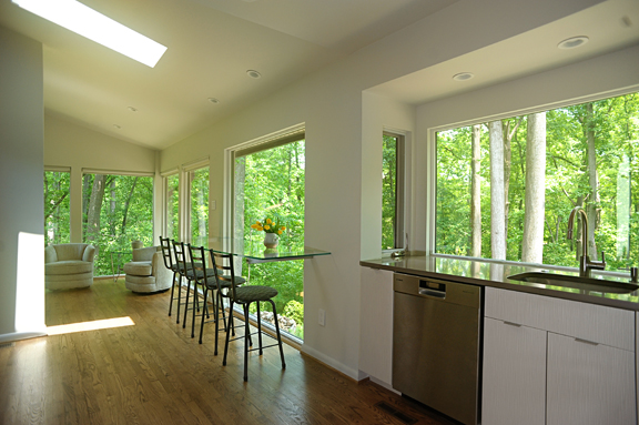 {Hardwood flooring works well to unify this open floor plan kitchen & sunroom. Design by  April Force Pardoe Interiors .}