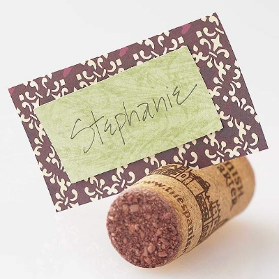 {Easy place card holder. Use papers that compliment your linens.}