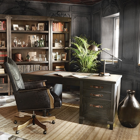 {The ornate, dark walls in this home office envelope this swanky home office in warmth. From:  Arhaus .}