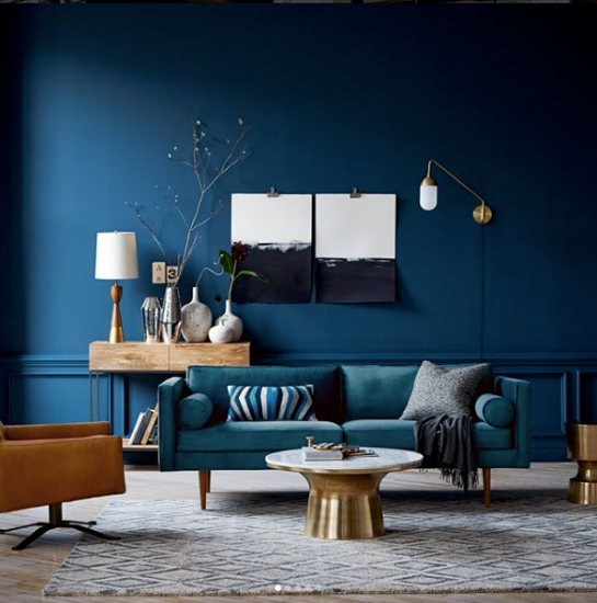 {This teal Monroe mid-century style sofa pairs oh-so-well with the jewel-toned wall just behind. From  West Elm .}