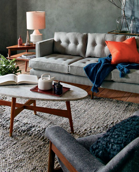 {The monochromatic palette allows the colorful accents to really shine! From:  West Elm .}