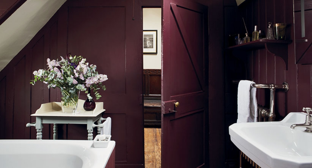 {This bathroom is certainly not lacking in color or character. From:  Farrow & Ball .}