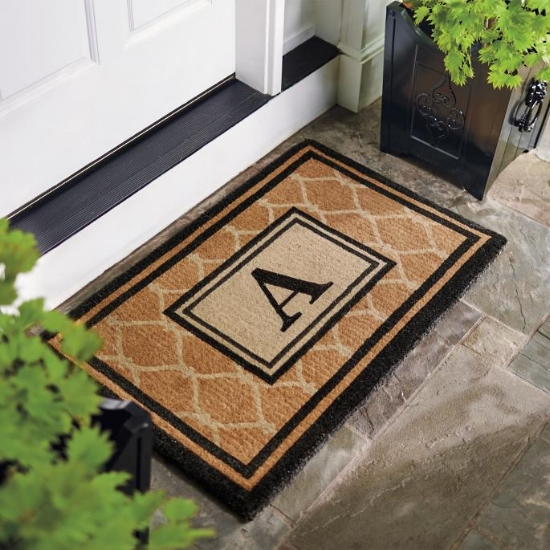 {This monogramed welcome mat has an estate-esque air about it. A great option for the homeowner with a more formal, classic style. From:  Frontgate .}