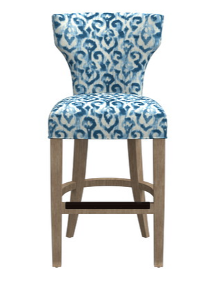 {A bold shades of blue fabric adds a fun element to a classic stool. From:  Crate & Barrel .}