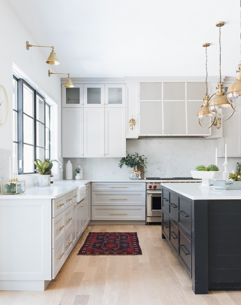 {The antique brass finish ties all of the kitchen light fixtures together. From:  Home Bunch .}