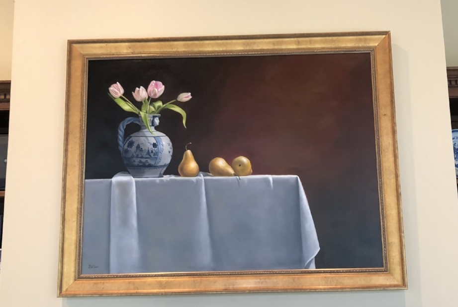 {The stunning still life above Beverly's dining room fireplace.}