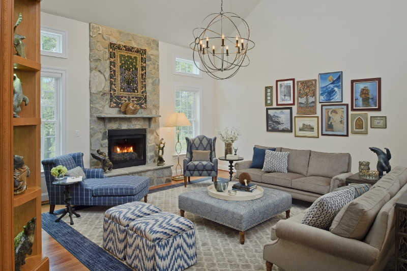 {For our  Bluebell Way  project, we created a cozy family room using several strategies to make this spacious, two-story room feel warm, inviting and intimate. Design by April Force Pardoe Interiors.}