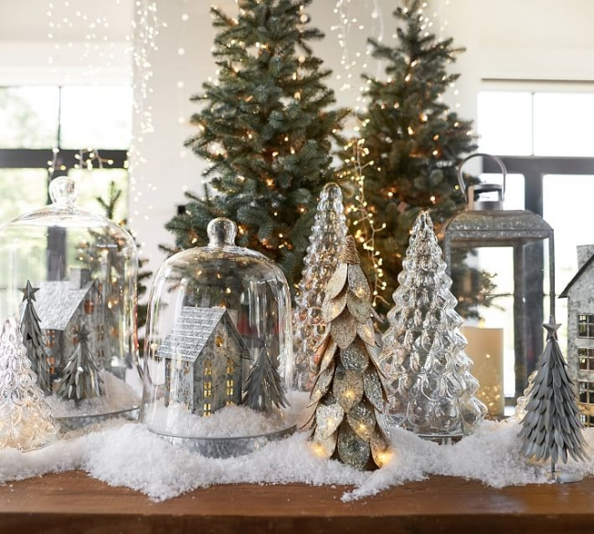 {This is my favorite snow decor - metallic, evergreens and glass. Simply lovely! From:  Pottery Barn .}