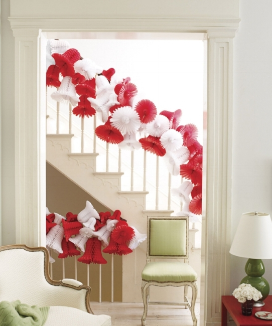 (Designer Robert Ruffino thought outside of the holiday box using paper wedding bells in seasonal colors to cover the banister. From:  House Beautiful .)