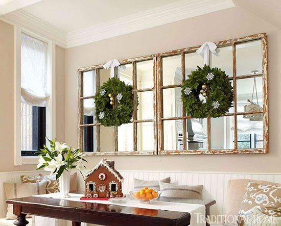 {You can also embellish your mounted wall mirrors by hanging swags or wreaths in front of them. From:  Traditional Home .}