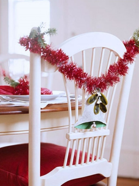 {A chair gets dressed up with red garland. From  Better Homes & Gardens .}