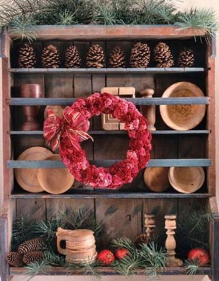 {The pine cones lined up along the top shelf are just as charming as the ones tossed in with the greens at the bottom. From:  Country Living .}