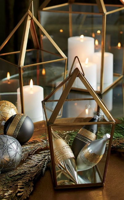 {Fill metallic containers with metallic accessories... I love the variety of metals and finishes in this display. From:  Crate & Barrel .}